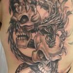 dragon_skulls_tattoo_by_2face_tattoo