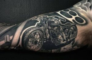 black_motorcycle_and_brass_knuckles_forearm_tattoo