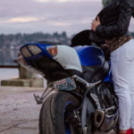 Girl by motorcyle from Unsplash Greg Raines